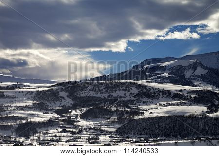 Winter Mountains And Village At Evening