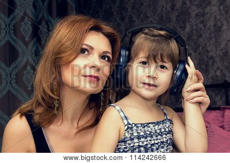 Mother And Daugther Listens To Music.