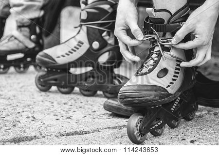 Man Putting On Roller Skates Outdoor.