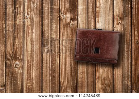 Brown Leather Wallet On Wooden Background