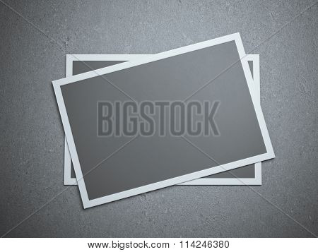 Two  blank cards on the gray studio floor
