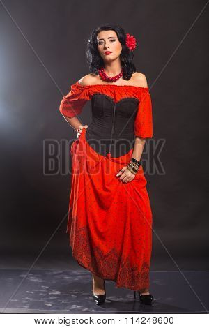 The image, chic, sexy Spaniard. Chic, sexy woman in a red dress.