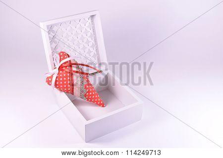Handmade heart in a white openwork casket