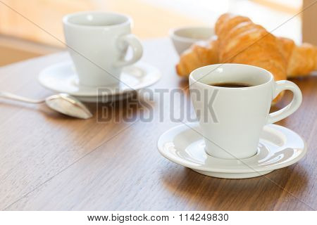 Fresh morning coffee with croissants.