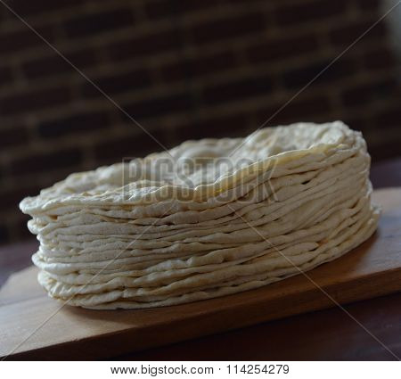 a pile of flat bread: Stack of pita bread