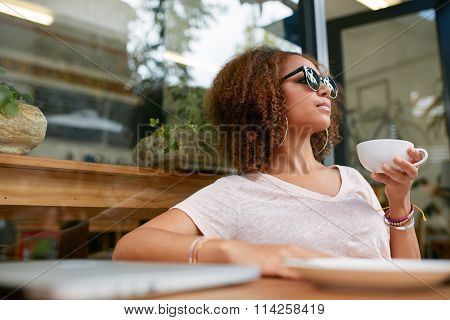 Stylish Girl Having Coffee At Sidewalk Cafe