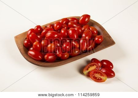 A Bowl Of Grape Tomatoes Over A White Background