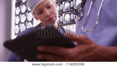 Doctors Using Devices In The Office