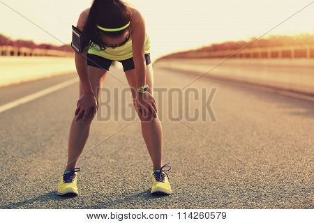 young fitness woman runner running on city bridge road