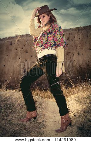 cowgirl style fashion young woman, outdoor day shot, full body shot