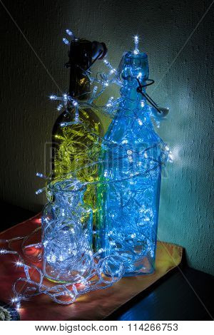 Christmas decorations glowing light bulb in the bottle