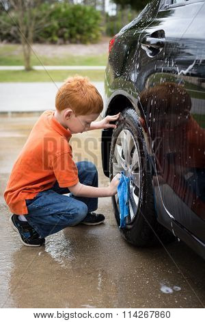 Little Boy Helping Wash His Father's Car