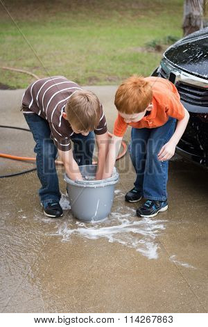 Two Little Boys Helping Wash The Car
