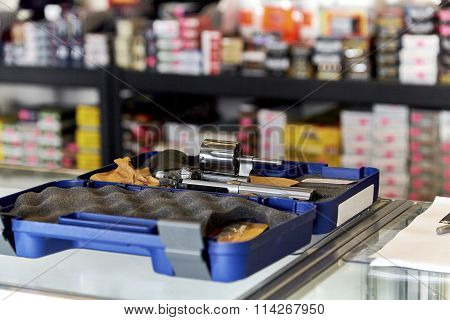 Revolver On Counter In Retail Store