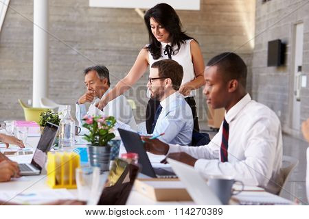 Businesswoman Working With Colleagues At Boardroom Table