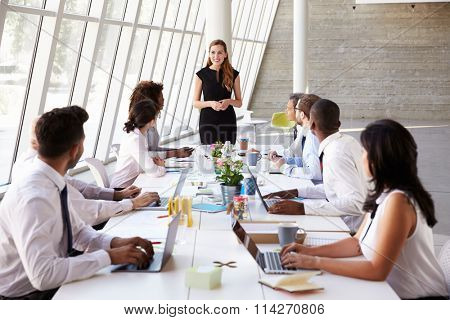 Caucasian Businesswoman Leading Meeting At Boardroom Table