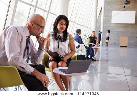 Business Meetings In Busy Office Foyer Area