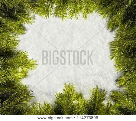 Fir branches frame on snow background