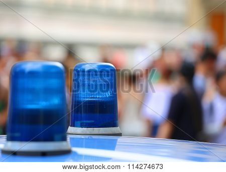 Two Blue Lights Siren Of A Police Car In The City