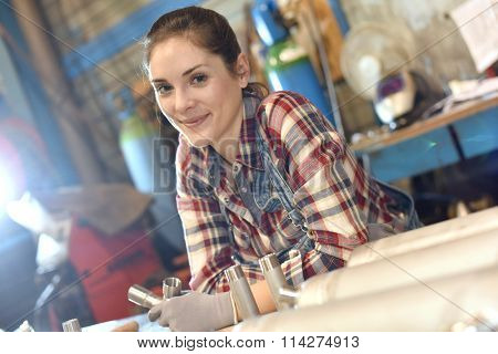 Woman in metallurgy workshop