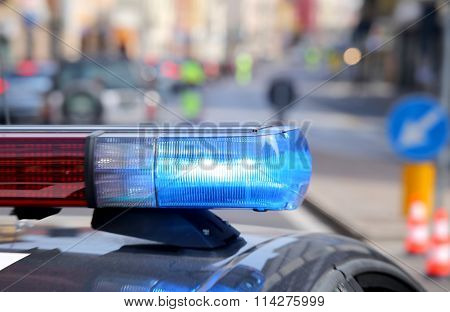 Blue Flashing Police Car During A Roadblock