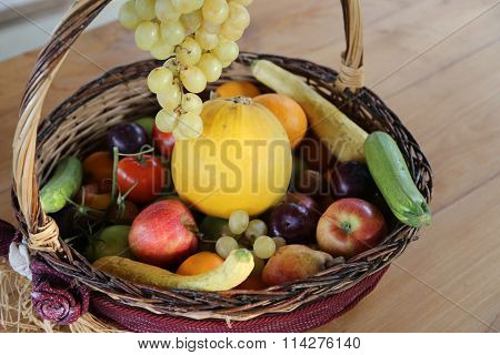 Wicker Basket With Lots Of Fresh Fruit In Autumn