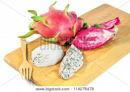 Slices Dragon Fruit on a wooden trencher