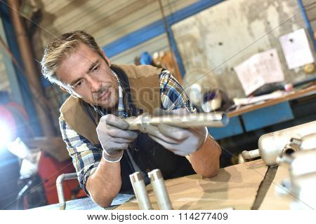 Worker in metallurgy workshop