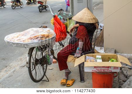 HO CHI MINH CITY, VIETNAM - JAN 12, 2016: Unidentified local woman street vendor. By the end of 2014, the city's GDP grew 9.5%, with GDP per capita reaching $5100.