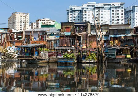 HO CHI MINH CITY, VIETNAM - JAN 11, 2016: Floating market with reflection in water. Is located in the South of Vietnam, is the country's largest city, population 8 million.