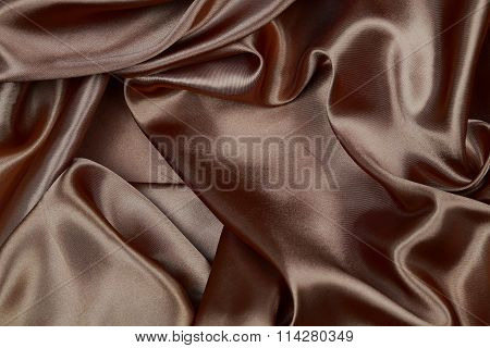 Brown Silk Texture Satin Velvet Material Or Elegant Wallpaper Design Curve Folds Wavy Background