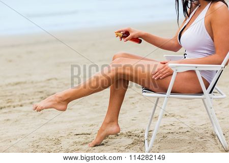close up of woman sunbathing on beach