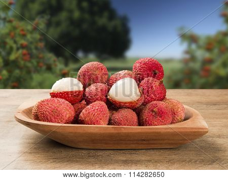Fresh Lychees On Wooden Surface.
