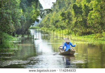 Woman rowing on the River Country