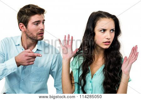 Couple sitting on chairs having argument over white background