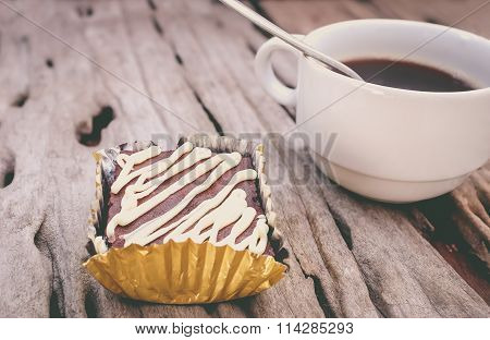 Cake Chocolate Brownie And Hot Coffee On Old Wooden Background. Retro Style.