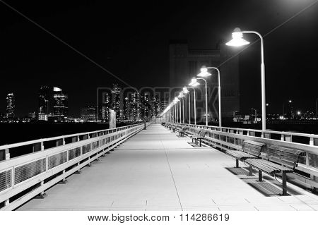 Night bridge with lanterns and benches in Night New York