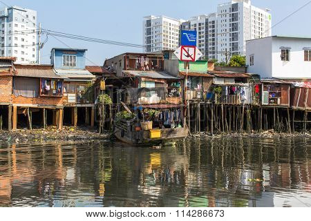 HO CHI MINH, VIETNAM - JAN 11, 2016: Views of the city's Slums from the river. Although the city takes up just 0.6% of the country's land area, it contains 8.34% of the population of Vietnam.