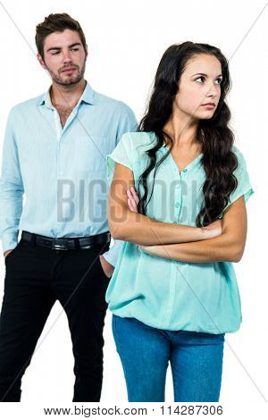 Couple not talking after argument over white background