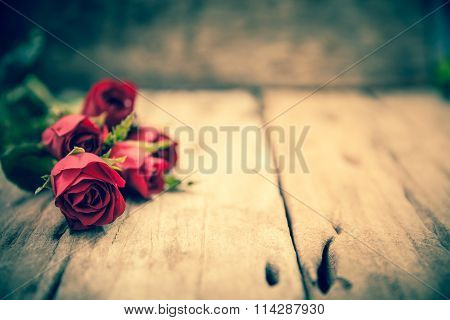 Red Roses For Valentine's Day On Blurred Wooden Background.  Cross Process.