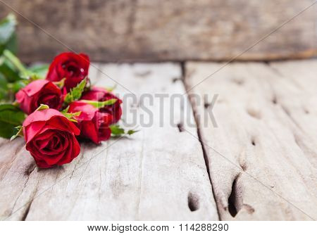 Red Roses For Valentine's Day On Blurred Wooden Background.