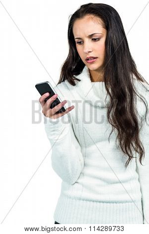 Worried woman using smartphone on white screen