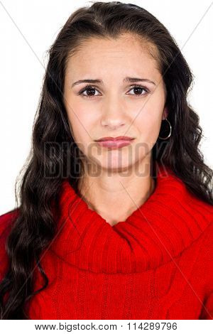 Sad woman looking at camera on white bacground