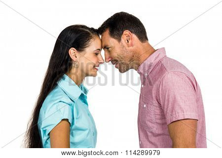 Smiling couple face touching foreheads on white background