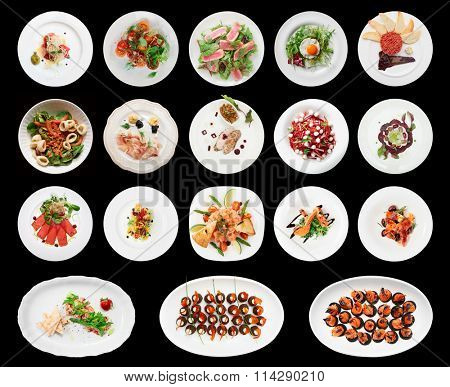 Set of various appetizers on black background