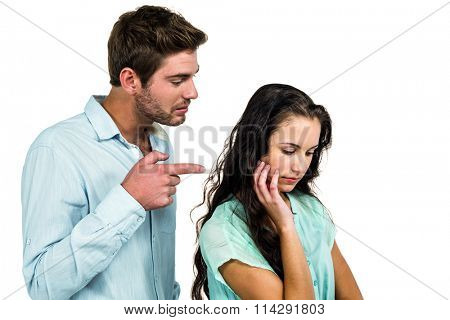 Frustrated couple arguing on white background