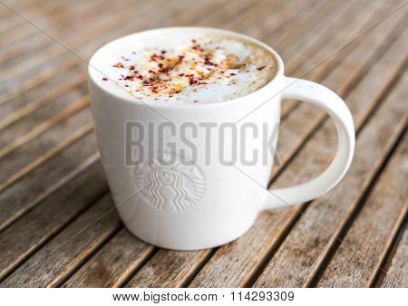 Khonkaen Province, Thailand - December 20, 2015 : Glass of Starbuck Coffee Blended Beverages served at wood table in starbuck shop at Khonkaen , Thailand.