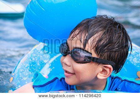 Close Up Funny Asian Boy With Swim Tube In Pool. Outdoor.
