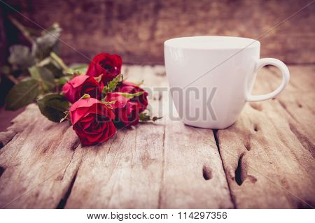 Red Roses For Valentine's Day On Blurred Wooden Background. Retro Style.