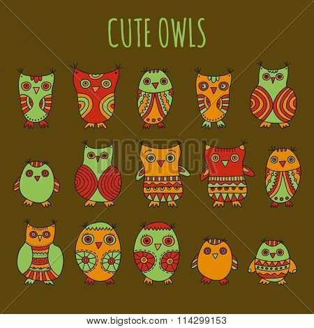 Set of bright cartoon owls and owlets on a dark background